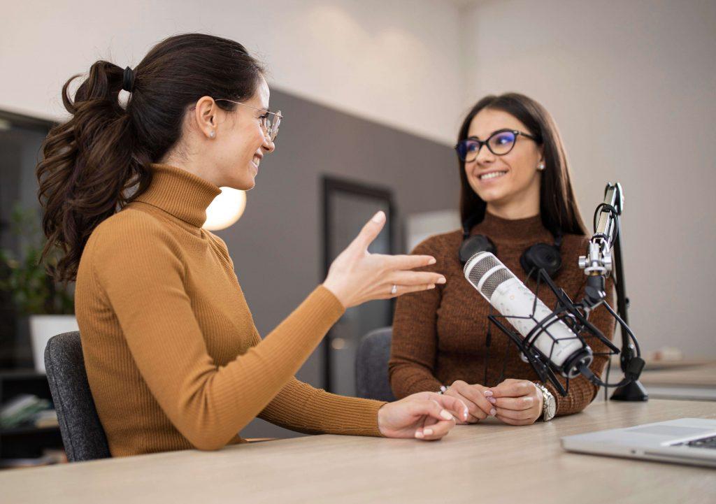 smiley women broadcasting radio together - Media Training Worldwide